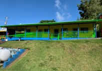 Exterior of a space to rent (green paint) in Kohala Town Center, 54-3886 Akoni Pule Highway Kapaau, HI 96755