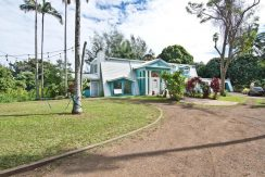 Main house front with circular driveway of a 4 beds 4 baths North Kohala home on behalf of Holly Algood, of Algood Hawaii, LLC